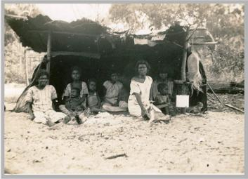 Women and Children at an old Camp, Lockhart River region, ca. 1930 (Attribute: State Library of Queensland)